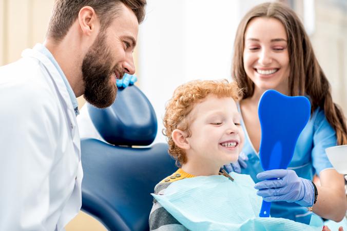 Doctor Boy Mom Looking at Teeth